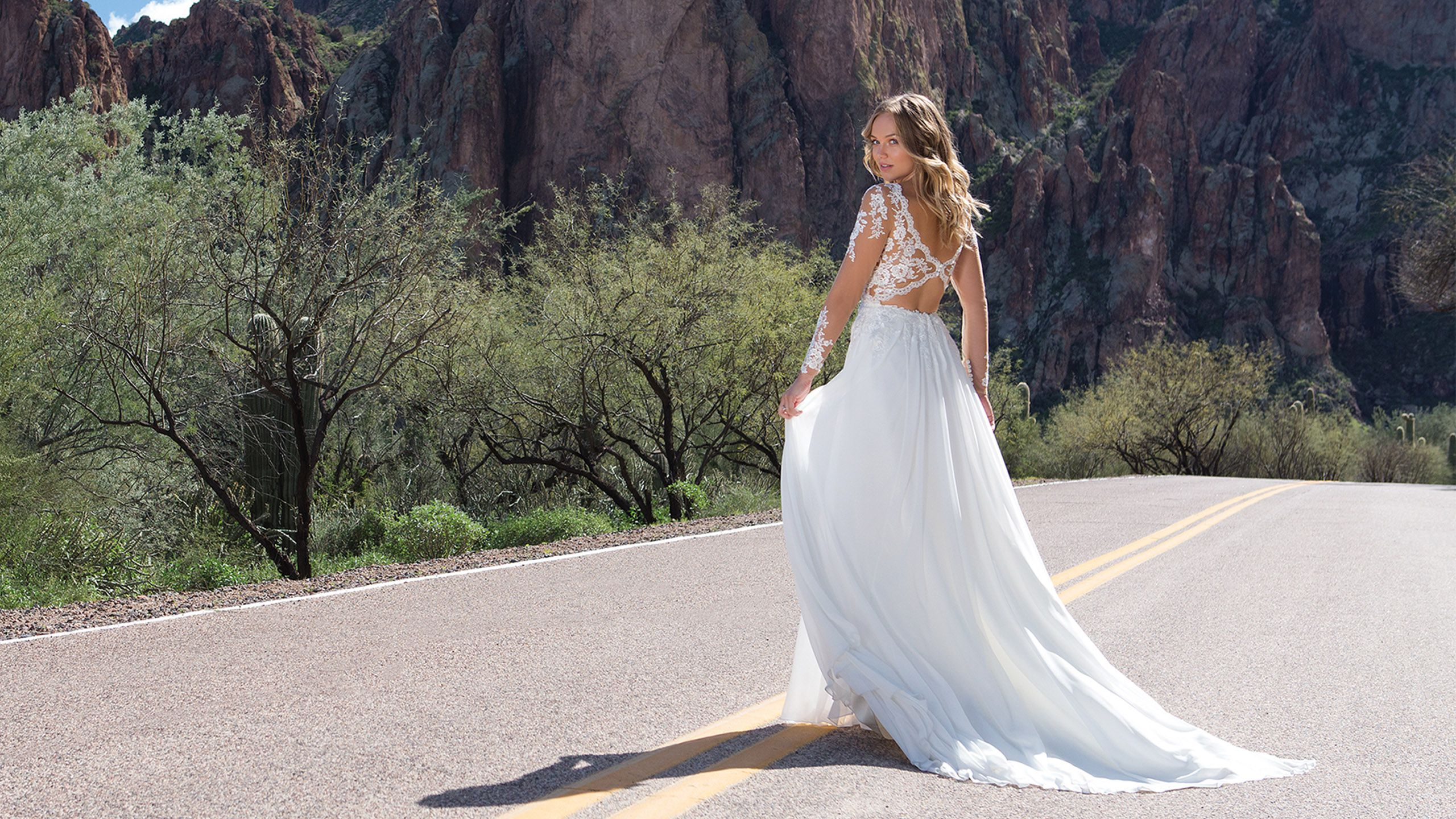 - Style 1130: Lace V-Neck Gown with Illusion Sleeves and Keyhole Back