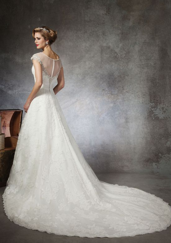 Justin Alexander Style 8664 Lace ball gown accented with a Sabrina neckline