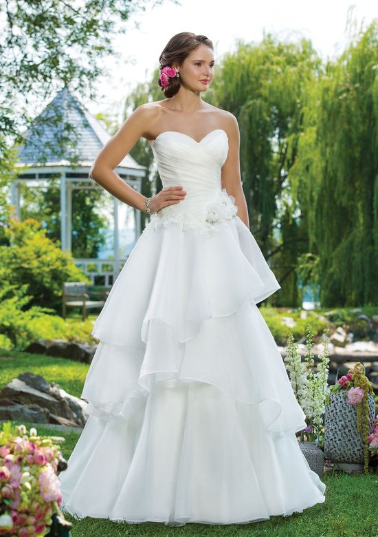 Sweetheart Gowns Style 6100 Embroidered lace and organza A-line adorned by a sweetheart neckline.