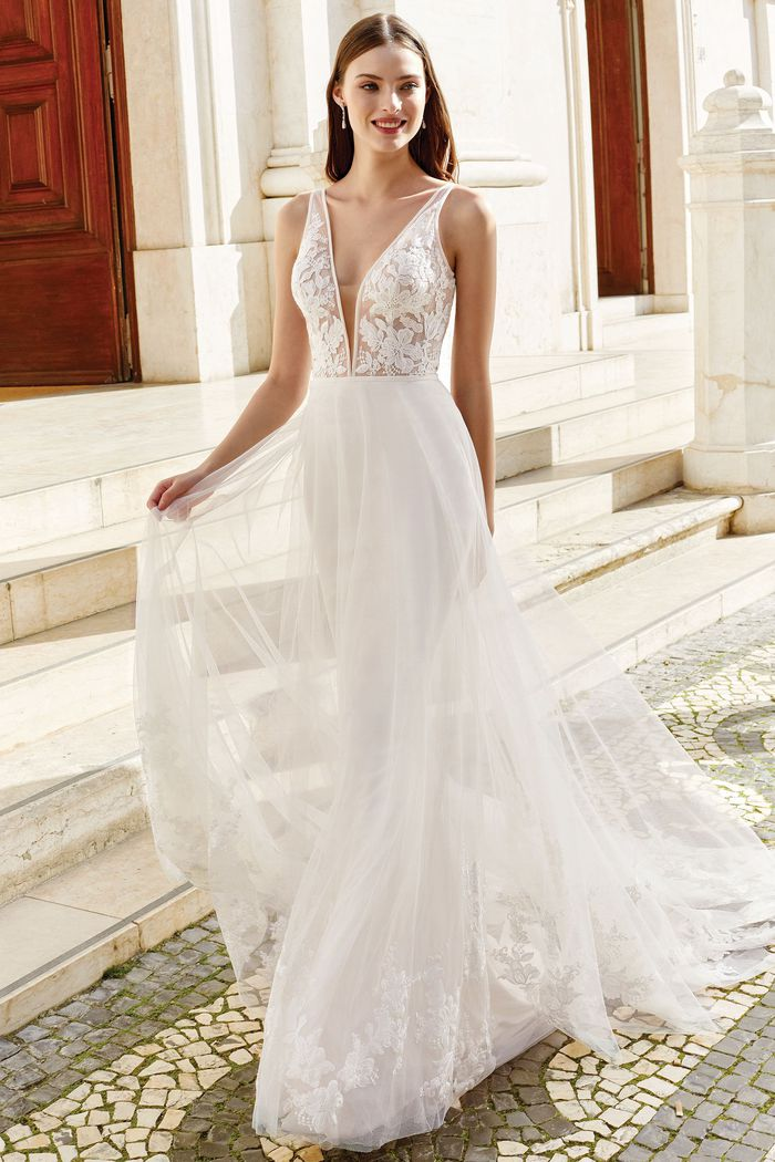 Adore by Justin Alexander Style 11158 V-Neck Cage Dress with Organza Trim Detail