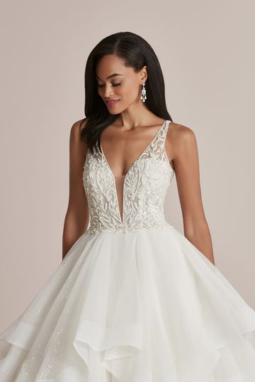 Justin Alexander Style 88227 Carissa Glitter Tulle Ball Gown with Ruffle Skirt and Plunging V-Neckline