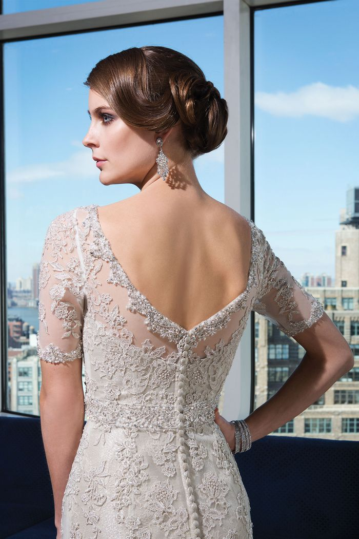 Justin Alexander Signature Style 9730 Beaded lace fit and flare dress accentuated by a Sabrina neckline