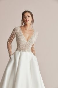 Justin Alexander Style 88216 Carson Beaded Long Sleeve Ball Gown with Mikado Skirt and Pockets