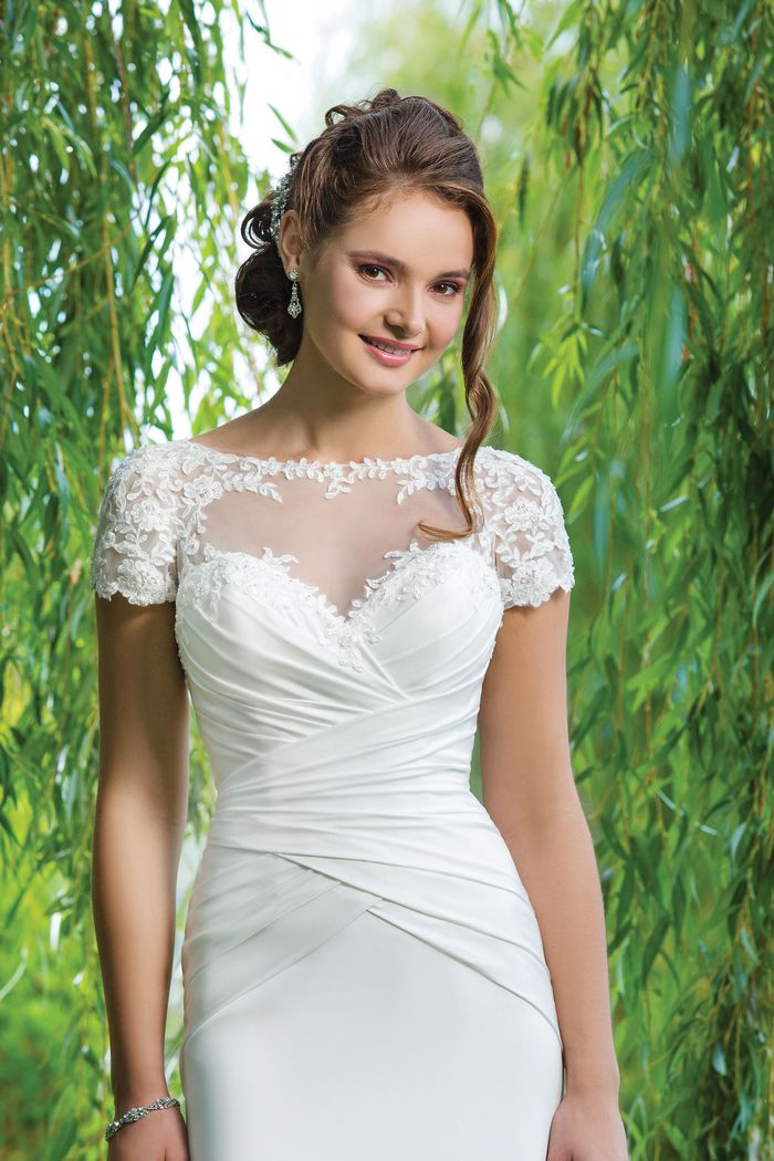 Sweetheart Gowns Style 6094 Beaded embroidered lace and jersey straight accented by a sabrina neckline.