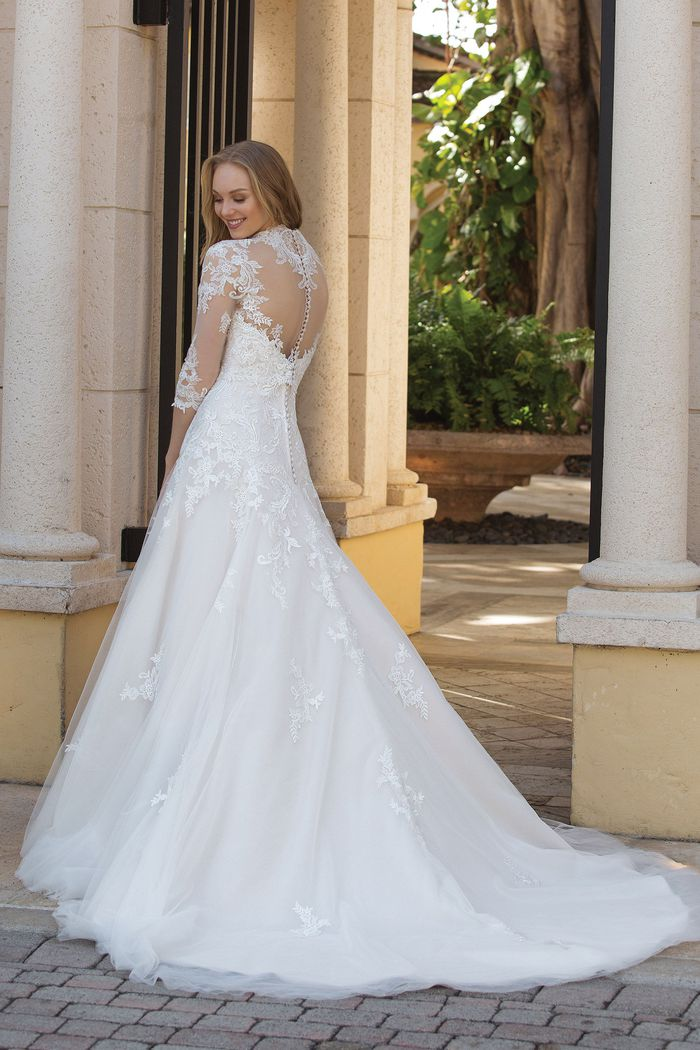 Sincerity Bridal Style 44095 Lace A-line Gown paired with a Queen Anne Jacket