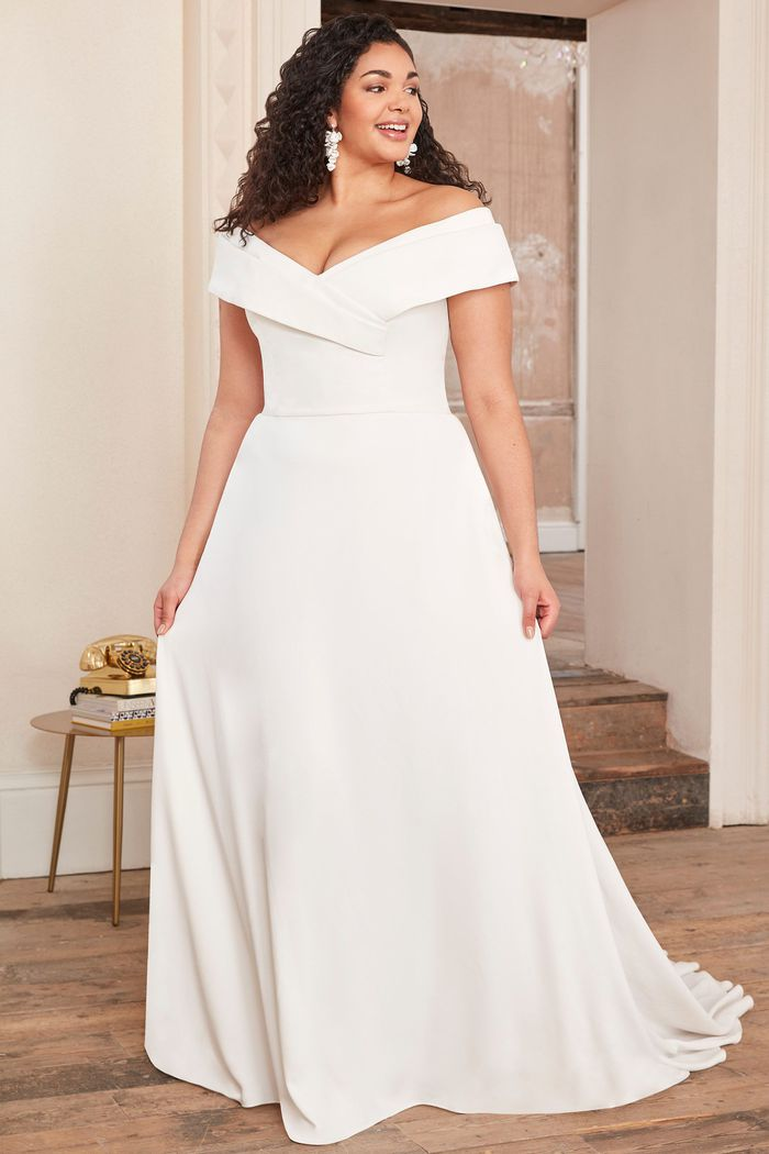 Adore by Justin Alexander Style11115PS Plus Size Crepe Dress with Cuffed Off the Shoulder Neckline
