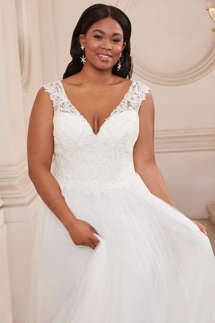 Adore by Justin Alexander Style11124PS English Net Plus Size Slim Ball Gown with Beaded V-Neck