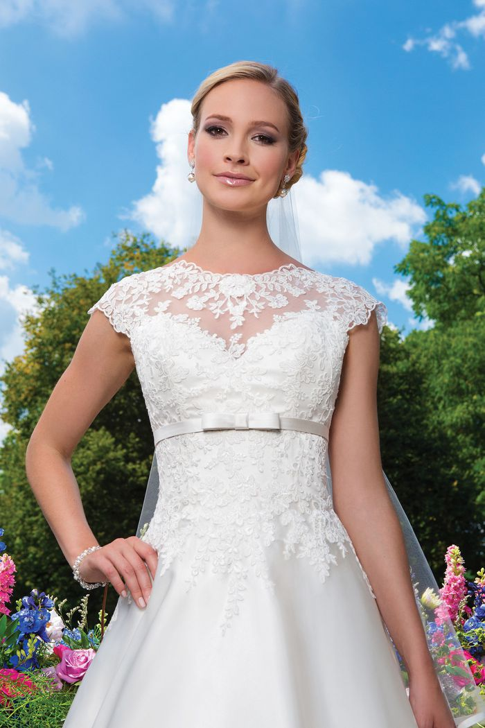 Sincerity Bridal Style 3873 Embroidered lace; satin and tulle A-linecomplemented with a sabrina neckline.