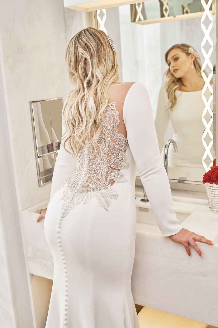 Justin Alexander Style 8936 Crepe Long Sleeved Wedding Dress with Beaded Illusion Back Iskra Lawrence