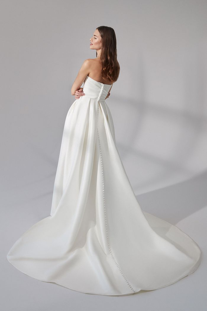 Justin Alexander Signature Style 99173 Beacon Strapless Stretch Mikado Gown with Asymmetric Pleating and Slit