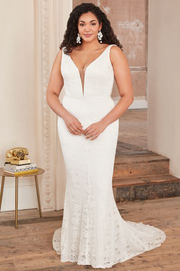 Adore by Justin Alexander Style11130PS Plunging V-Neck Plus Size Fit and Flare Dress with Low Back