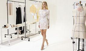 Justin Alexander Signature Style 99210 Cher Lace Mini Dress with Sabrina Neckline and Puff Sleeves