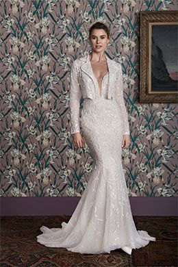 beaded fit and flare gown with a bridal jacket