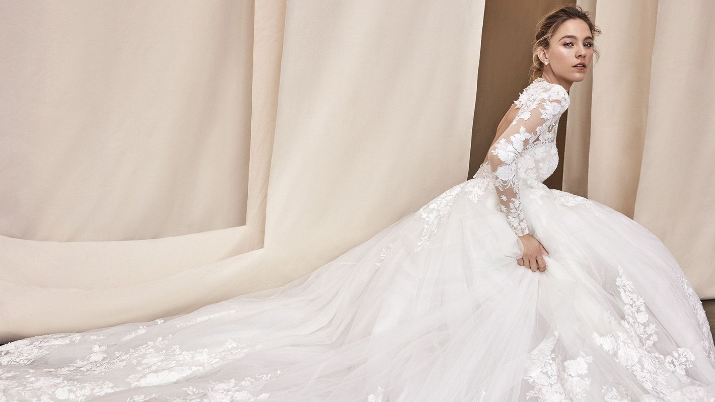 - Style 99071: Long Sleeve Laser Cut Lace Ball Gown