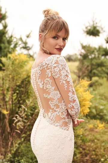 Lillian West Style 66197 Long Sleeve Lace Fit and Flare Dress with Illusion Side Cutouts