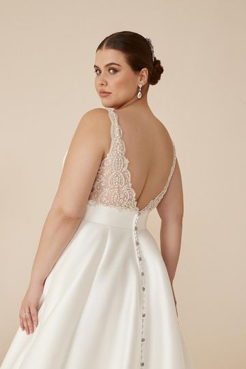 Justin Alexander Style 88208PS Camryn Clean Plus Size Mikado Ball Gown with Beaded V-Back