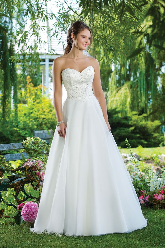 Sweetheart Gowns Style 6098 Beaded emboridery, Organza A-line emphasized by a sweetheart neckline.