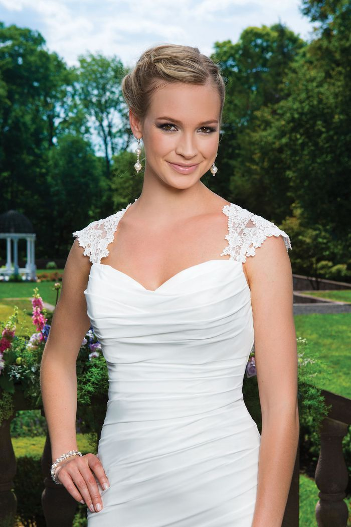 Sincerity Bridal Style 3865 Venice lace and chiffon fit and flare complemented by a sweetheart neckline.