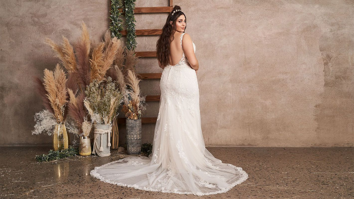 - Style 66143PS: Plus Size Fit and Flare Gown with Low Back and Side Cutouts