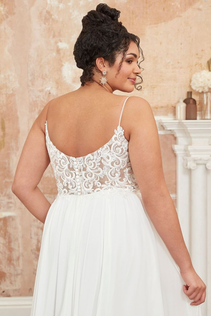 Adore by Justin Alexander Style11107PS Plus Size Chiffon A-Line Dress with Plunging Bikini Neckline