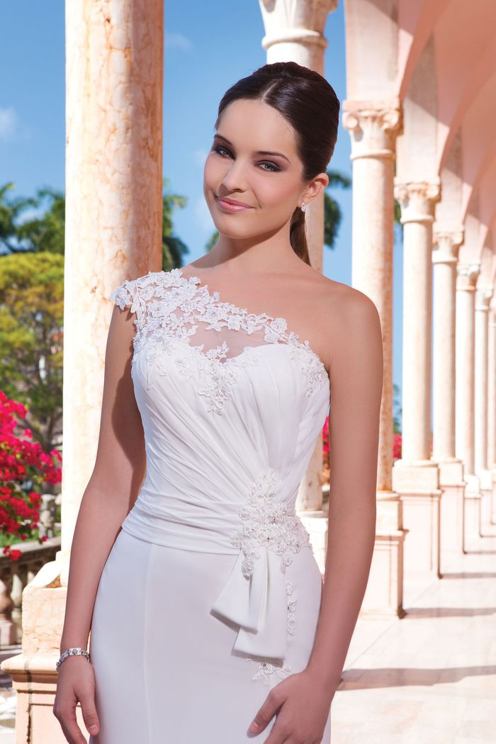 Sweetheart Gowns Style 6041 Chiffon fit and flare dress with an assymetrical neckline