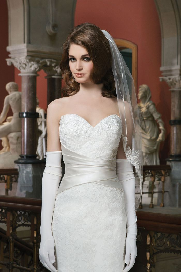 Justin Alexander Style 8713 Lace fit and flare dress highlighted with a sweetheart neckline