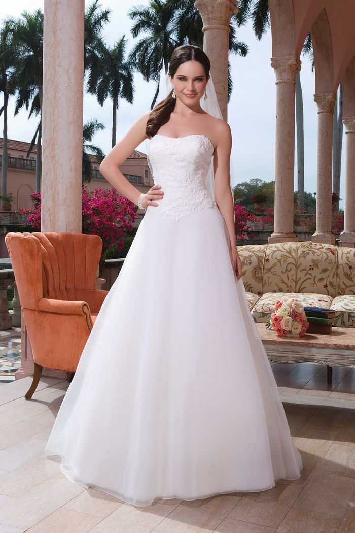 Sweetheart Gowns Style 6080 Organza, venice lace A-line dress featuring a strapless neckline
