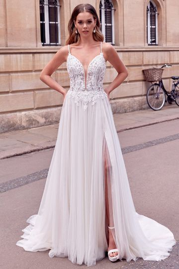 Adore by Justin Alexander Style 11185 Caia A-Line Dress with Plunging Bikini Neckline and English Net Skirt