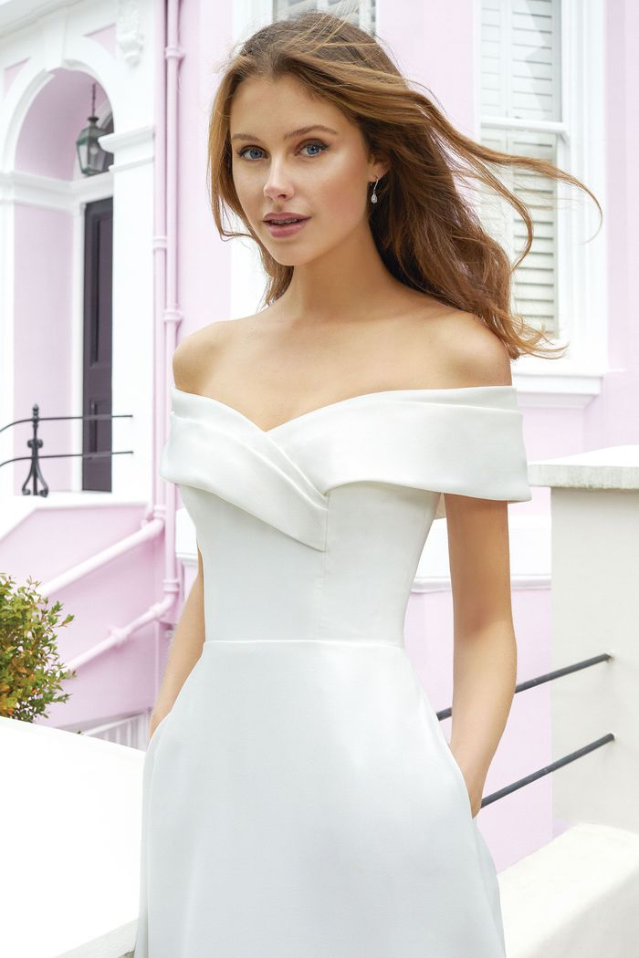 Adore by Justin Alexander Style 11115 Crepe A-Line Gown with Wide Off The Shoulder Cuff and Pockets