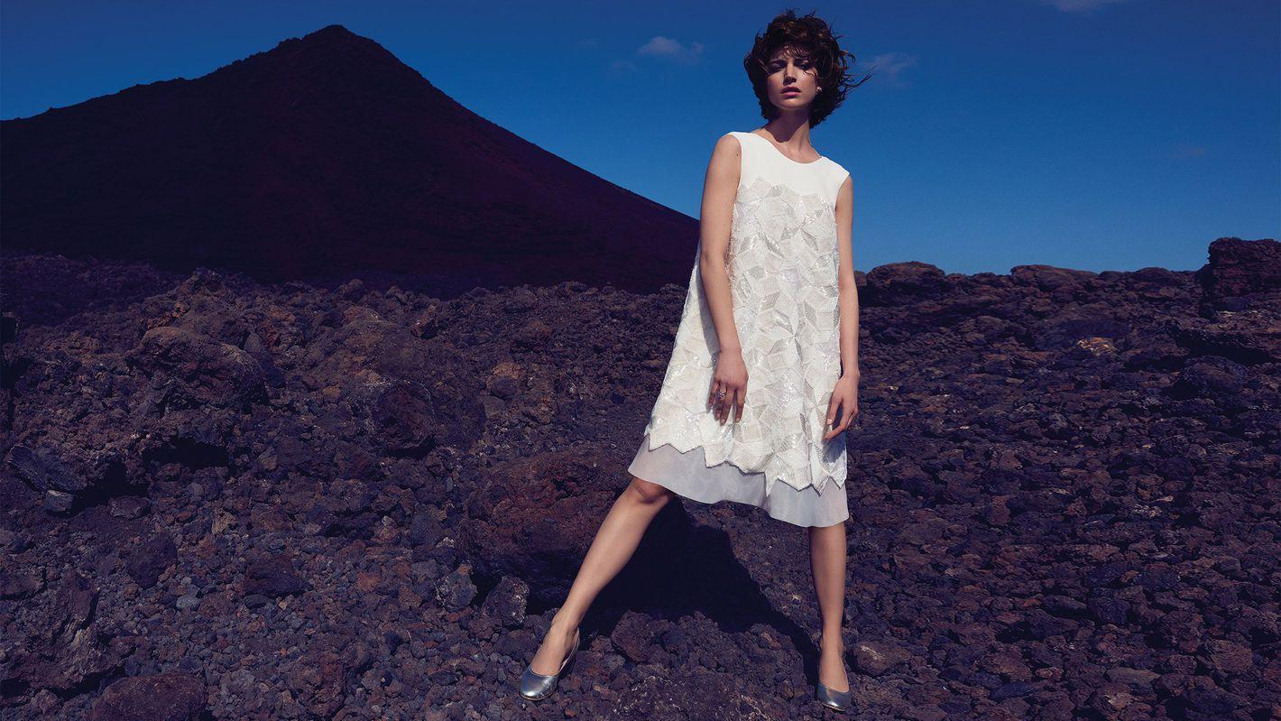 - Style 99035: Geometric Beaded Short Dress with Jewel Neckline